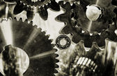 Cogwheels and ball-bearings in antique toning effect — Stock Photo