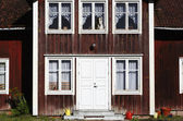 Old house with giant dog in window — Foto de Stock