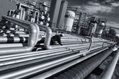 Pipelines leading to oil and gas refinery — Stock Photo