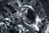 Mechanic with giant cogwheels machinery — Stock Photo