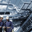 Refinery workers and pipelines — Stock Photo #57906145