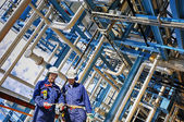 Chemical oil and gas industry with refinery-workers — Stock Photo