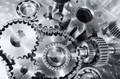 Cogwheels, gears and timing chains, titanium and steel — Stock Photo