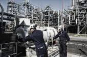 Oil workers and engineers — Stock Photo