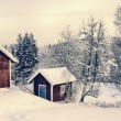 Old rural cottages draped in a snowy winter landscape — Stock Photo #60201455