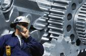 Worker with large cogwheels machinery — Stock Photo