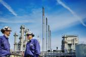 Oil workers, refinery and industry — Stock Photo