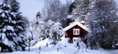 Old rural cottages surrounded by snowy winter scape — Stock Photo