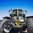 Large farming tractor with giant tires — Stock Photo #61249003