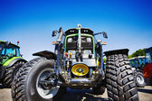 Large farming tractor with giant tires — Foto de Stock