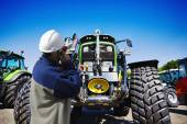 Farming tractor and mechanic — Stock Photo