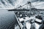 Container port and ship in action — Stock Photo