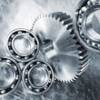 Titanium and steel ball-bearings and cogs — Stock Photo #72864693