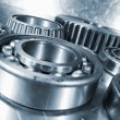 Titanium and steel ball-bearings and cogs — Stock Photo #72864723