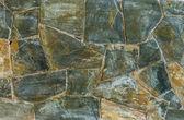 Achtergrond van leisteen stenen muur oppervlak — Stockfoto