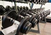 Black dumbbell in fitness room — Foto de Stock
