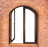 Black arch door on red brick wall — Stock Photo