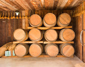 Close up wine barrels stacked — Stock Photo