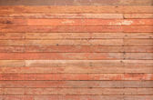 Pattern detail of old red wood strip texture — 图库照片