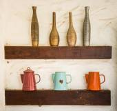 Colorful vase baked clay and steel jug put on wood shelf — Stock Photo