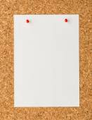 White paper note sheet with red push pin on cork board — Stock Photo