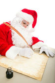 Santa Writing List on Parchment — Stock Photo