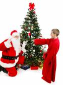Boy Surprises Santa Claus — Stock Photo