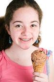 Girl with Braces Eating Ice Cream — Stock Photo