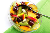 Salad of fresh fruits and berries on a green cloth. — ストック写真