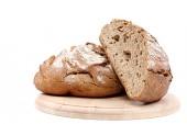 Vers brood op een houten bord. — Stockfoto