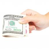 Beautiful female hand holding a stack of banknotes. — Stock Photo