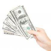 Mooie vrouwelijke hand met een stapel bankbiljetten. — Stockfoto