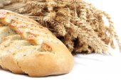 Bread and wheat ears on white background. — Stock Photo