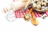 Quail eggs, flour and cooking utensils on canvas on white backgr — Stock fotografie
