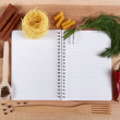 Baking ingredients for cooking and notebook for recipes on a woo — Stock Photo #70485863