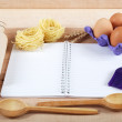 Baking ingredients for cooking and notebook for recipes on a woo — Stock Photo #70486627