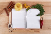 Baking ingredients for cooking and notebook for recipes on a woo — Fotografia Stock