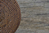 Half lid basket on antique table (Top view) — Stock Photo