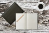 Grid notebook with wood pencil and coffee on table (Top View) — Stock fotografie