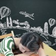 Asian woman dreaming and thinking travel holidays on blackboard — Stock Photo #55937061
