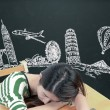 Asian woman dreaming and thinking travel holidays on blackboard — Stock Photo #55937065