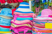 Colorful summer hats for sale — Stock Photo