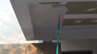 Painter worker paint ceiling house cement wall with rotate brush in white color — Stock Video