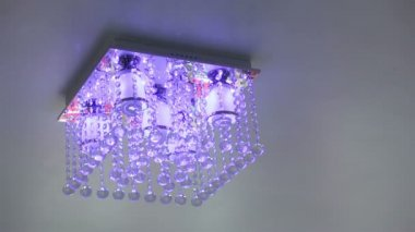 Crystal chandelier ceiling light turn on and off — Stock Video