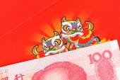 Chinese or 100 Yuan banknotes money in red envelope, as chinese  — Stock Photo