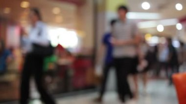 Abstract blur background of shopping mall and crowd of walking people use escalator in the shopping mall center with bokeh — 图库视频影像