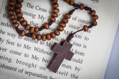 Christian cross necklace on Holy Bible book, Jesus religion conc — Stock Photo