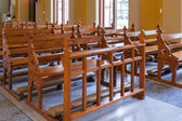 Wood Bench of Catholic church, people can pray for god jesus — Stockfoto