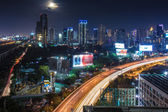 Business Building Bangkok city area at night life with transport — Stock Photo