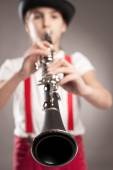 Little girl playing clarinet — Stock Photo